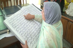 Punjab Official Visits Artist Who Embroidered Quran on Cloth